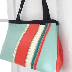 Bold and bright stripes - a perfect refresh for Spring. #hollyaikenbags #madeinnorthcarolina