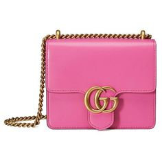 The small GG Marmont chain shoulder bag has a structured shape and oversized flap closure completed with our Double G hardware. The sliding chain strap can be worn multiple ways, changing between a shoulder and a top handle bag. Made in ...