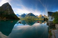 Mountain reflection on lake in Hjelle, Norway. #BucketList