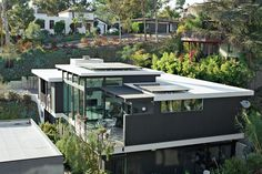 A multi-generational home in San Diego, California, elegantly combines sustainability and luxury. The flat roof of the Nakhshabs' energy-efficient home is topped with photo-voltaic panels. It is the first single-family LEED Gold–certified residence in San Diego. Photo by Ye Rin Mok.  Photo by: Ye Rin Mok