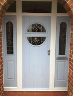 Front door: modern composite door in duck egg blue with decorative glass design and matching side panels by Majestic Designs (@Majestic Designs).