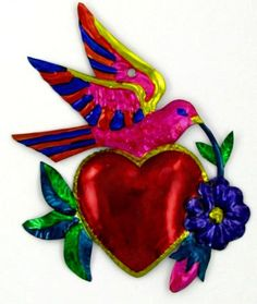 Mexican tin heart with dove