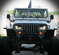 Angry Eyes for your Jeep.  I totally want to do this to the jeep, but just the eyelid, not the eye detail. It'd look so badass. Wonder if I can plasti dip it on there??