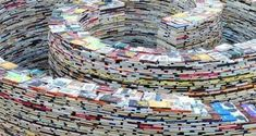 """London 2012 Festival - July 26 - 30. Constructed of 250,000 books, called aMAZEme. Inside, a number of surprises await! Small screens are installed throughout the labyrinth which show art images and literary quotes. In addition, various authors will be reading their books inside the maze, """"adding life to the project via oral tradition."""" At the end of the exhibition, the public is encouraged to take any of these new and used books home with them."""