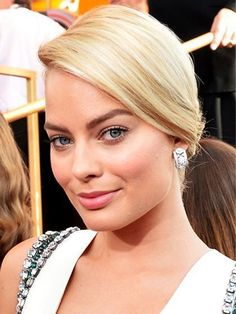 The Most Flattering Blonde Hair Colors for Every Skin Tone -- Margot Robbie: Fair Skin, Golden blonde hair pulled back into a low updo with rosy cheeks and lips | allure.com