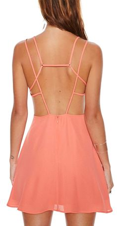 Cage back... This backing on a maxi dress using same material would be stunning.