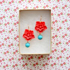 """Bright Matte red flowers .75"""" round (20mm) with aqua vintage glass jewels dangling down. The earrings measure A little over 1"""" long. The ear wires are gold plated over surgical steel perfect for sensi"""