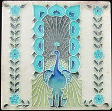 Rare nouveau tile from the Mintons China Works depicting a peacock with fantastic heart shaped feathers in turquoise and royal blue.