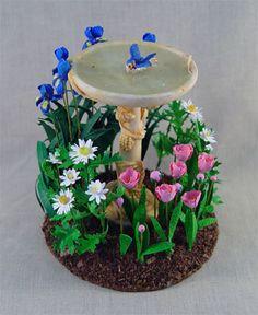 ".  BLUE BIRD GARDENDorrie Toth This adorable blue bird garden is   3 1/2"" in diameter, it contains 24 flowers; ""Dutch Blue"" bearded iris, ""Crazy Daisy"" shasta daisy, ""Angelique"" Holland tulip and the small daisy ""Marguerite"".  ."
