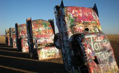 If you're driving along Route 66 just west of Amarillo, Texas, stop by Cadillac Ranch, an art installation featuring 10 Cadillacs sticking out of the ground head-first. Commissioned by Stanley Marsh and created by a group of artists from San Francisco in 1974, the site is a tribute to the car's unique tail fin design between 1949 and 1963. (From: 25 WACKIEST Roadside Attractions in America!)