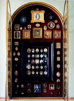 Cabinet of miniature antique portraits. Eve, a miniature portraitist, got Asa to model for her in Hoyt's Sweetest Scoundrel.