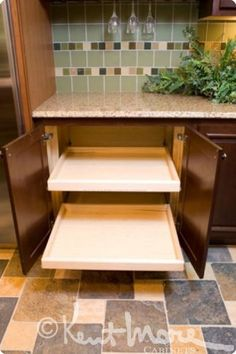 custom cabinetry by kent moore cabinets pull out drawers maple wood with classic chestnut. beautiful ideas. Home Design Ideas