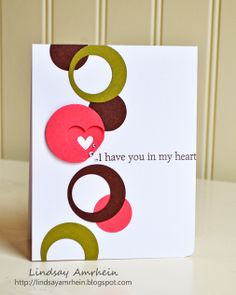 handmade card ,,, clean and simple ,,, white card base with olive, deep rose and deep chocolate ,,, column of punched circles ,,, some with off-set circles cut out ... focal point circle layered with heart punched at edge of top layer framing a smaller heart leaving negative space in bottom layer ... luv the graphic look ,,, Stampin' Up!