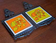Vintage tile and cast iron trivets with mushrooms, yellow and orange...Groovy Mushrooms.... $14.00, via Etsy.