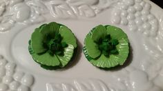 Check out this item in my Etsy shop https://www.etsy.com/listing/233568271/vintage-green-enamel-flower-clip