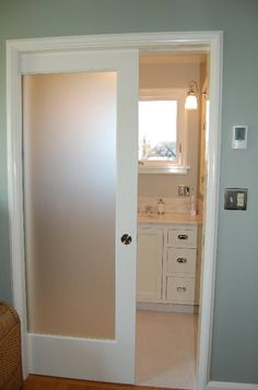 Maybe a glass pocket door between the laundry and mud room? Save on space and still allow to close the door.  Something to think about...