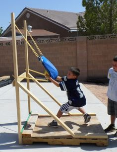 Angry Birds Birthday Party Ideas, games and food.  Awesome homemade slingshot!