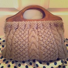 Vintage cable-knit handbag This is a one-of-kind beauty that perfectly compliments those fall/winter outfits. Brown wool knit, carved wooden handles, and green satin lining make this a unique piece that is sure to turn heads! Bags Totes