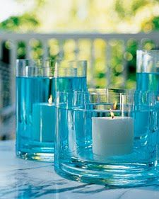 Fire & Water Centerpiece - 2 glass vases, tinted water & candle via martha stewart. This illuminating centerpiece can be created by placing a glass vase inside another that is slightly larger, and filled with tinted water. Water Centerpieces, Simple Centerpieces, Baby Shower Centerpieces, Wedding Centerpieces, Centerpiece Ideas, Graduation Centerpiece, Quinceanera Centerpieces, Turquoise Centerpieces, Table Decorations