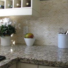Santa Cecilia granite with tumbled marble backsplash. @Esther Aduriz Aduriz Martin I bet this would look really good in your house.