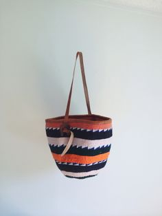 hand woven wool/leather bag made in kenya. 100% of the profits from this bag go toward digging a well in western kenya. read about the details at www.yadumuproject.org