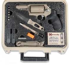 "Taurus, ""The First 24 Kit"" - 9 tools that will assist you in the 1st 24 hrs of a catastrophic event; in a waterproof / drop-proof SKB survival case; (1) Taurus Judge Revolver in XCOAT Tan (loads both: .45 Long Colt .410 shot-shell); (2) CRKT Sting Survival Knife; (3) Brite Strike EPLI Flashlight; (4) Brite Strike Emergency Signals; (5) Zippo Outdoors Emergency Fire Starter Kit; (6) Bianchi Speed Strips; (7) Suunto Compass; (8) Slim Line Battery Caddy 6 Batteries; (9) 550 Paracord Bundle;"