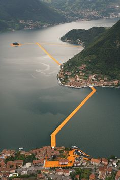"""The experience of a lifetime will soon be available to Italy's public. Thanks to artists Christo and Jeanne-Claude, a floating walkway now exists on Lake Iseo in northern Italy. The installation - """"The Floating Piers"""" - Land Art, Christo Floating Piers, Christo Y Jeanne Claude, Richard Long, Italian Lakes, Walk On Water, Environmental Art, Art Plastique, Public Art"""