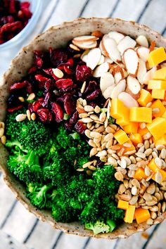 A delicious, simple, and quick lemon poppyseed broccoli salad. Broccoli, dried cranberries, sunflower seeds, sharp cheddar cheese, and sliced almonds.