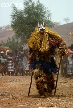 "Africa | A Bobo wears a ""loup"" mask and costume of vegetable fibre to dance at an agricultural religious festival in Burkina Faso. 