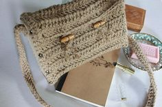 This bohochic crochet messenger bag is made of twine and wood. The bag is lined with a colorful bohemian fabric and easy to carry. It closes with two wooden buttons at the front of the bag. This bag is perfect for a bohemian and brocante style outfit. °°When ordering°° If you have any questions, please ask.