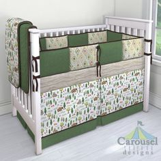 Crib bedding in Heather Grass Green, Watercolor Forest, Chocolate Suede, Solid Chocolate Brown, Taupe Woodgrain, Green Painted Diamond. Created using the Nursery Designer® by Carousel Designs where you mix and match from hundreds of fabrics to create your own unique baby bedding. #carouseldesigns