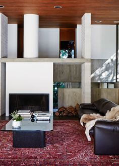 Harry Seidler House 1972. Main lounge room.  Harry Seidler coffee table, Vico Magistretti Maralunga sofa.  Photo - Sean Fennessy, production – Lucy Feagins / The Design Files.