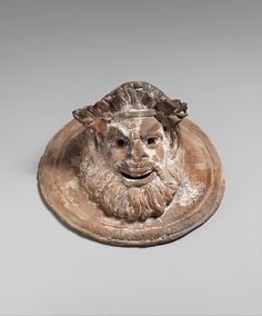 Terracotta roundel with mask of Pan | Greek | Hellenistic | The Met