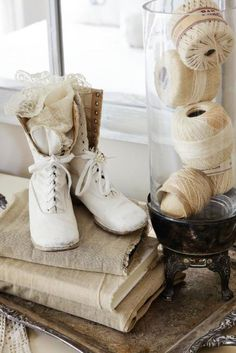 cover books in old linen for right coloring - lace, string, shoes, it all works!