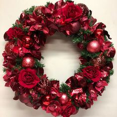 This dramatic red Christmas wreath makes a statement. Red Christmas, Christmas Decor, Christmas Wreaths, How To Make Wreaths, Christmas Swags, Holiday Burlap Wreath, Christmas Decorations, Ornament Crafts, Christmas Garlands