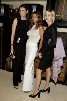 Julianna Margulies, Laura San Giacomo and Reese Witherspoon during Louis Vuitton Benefit for Chime Charter School Hosted by Laura San Giacomo in Beverly Hills, California, United States.