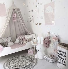 Kids room - white and grey with hits if soft pink. I love the rug.