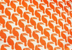 Orange tucan cotton fabric 1 yard. $6.50, via Etsy.