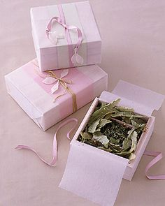 Tea Party Favor Japanese green tea leaves surrounded by French tilleul leaves are nestled in small wooden boxes and make beautiful party favors. They are wrapped in pale-pink vellum paper and ribbon, and then decorated with antique waxed leaves. Tea Party Favors, Pre Wedding Party, Rustic Wedding Favors, Wedding Favors Cheap, Wedding Ideas, Tea Party Bridal Shower, Baby Shower Favors, Japanese Party, Martha Stewart Weddings
