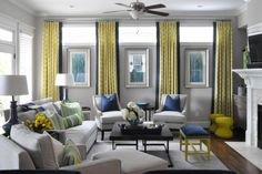 Make the illusion of large windows by adding either framed mirrors or prints between long drapes! Short, high windows are on top.
