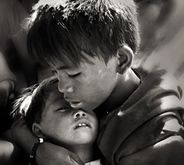 Disadvantaged Children - Photography by Thomas Tham  This image was take in 2009. The 2 boys were Bernard and his youngest brother Daryl. They were charcoal kids who lived in the charcoal factory.