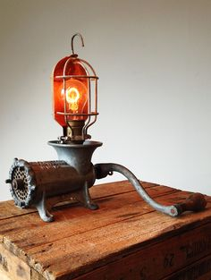 """Rusty Remakes Signature """"Dirty Harry"""". American table top meat grinder, combined with industrial lamp cage and carbon filament bulb."""