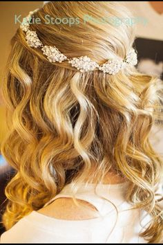 Half up half down wavy bridal hairstyle but with flowers instead of a diamond headband.