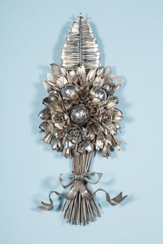 It honestly took me a solid minute to wrap my head around the fact that these silver sculptures are actually composed entirely of old spoons, forks and knives. Look closely . . . do you see it? In her latest series Bouquets and Butterflies, artist Ann Carrington clusters spoons together, bends
