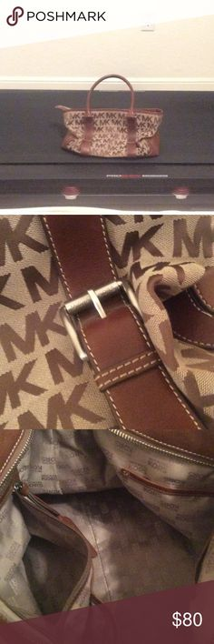 Like New Micheal Kors Medium Tote Micheal Kors. Leather buckles. Medium size. Tote. Clean inside. LIKE NEW. KORS Michael Kors Bags Totes