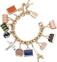 I love this Louis Vuitton 18K Yellow Gold World Travel Charm Bracelet with Lock, Key and Twelve Diamond, Onyx, Lapis & Topaz Charms