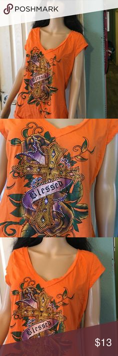 Blessed Shirt Lovely orange top tells the world you are blessed. Cross features sparkly studs that make this as pretty as the message it conveys. Dots Tops
