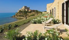 On Sicily's southern coast the Falconara Charming House & Resort is the restored servants'' quarters of the nearby Falconara Castle.