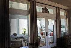 Transom windows, french doors, enclosed sunroom, hang curtains high, two-tone brown curtains
