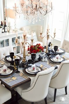 Gothic Dinner Party for Halloween in Elegant Dining Room with brass candelabras and black goblets